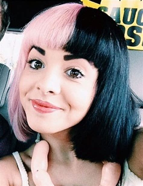 melanie martinez had short curly hair for her performance of cough melanie martinez had her hair in a double bun for