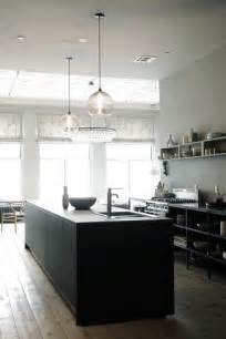 modern pendant lights for kitchen island a pair of niche modern solitaire pendants hangs the