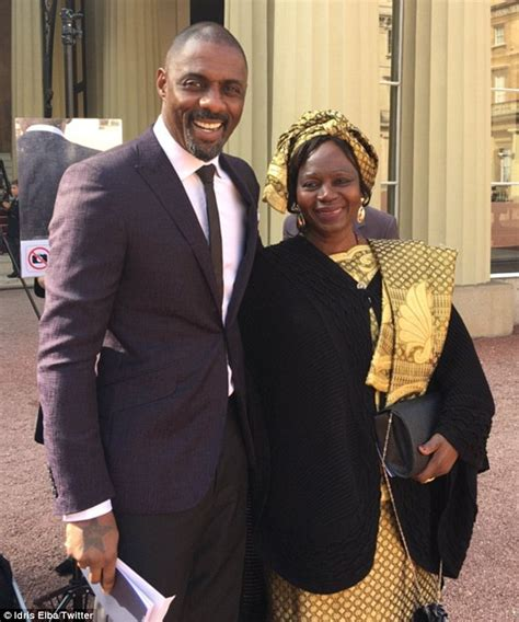 idris elba with his father winston elba during the opening idris elba beams as he poses with his mother after obe