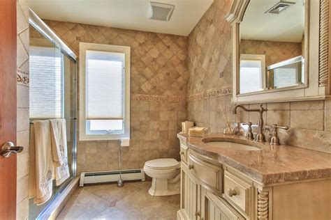 country full bathroom with flat panel cabinets by theresa