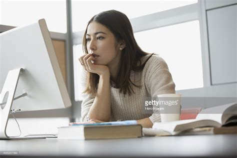 student on computer focused college student studying at computer stock photo