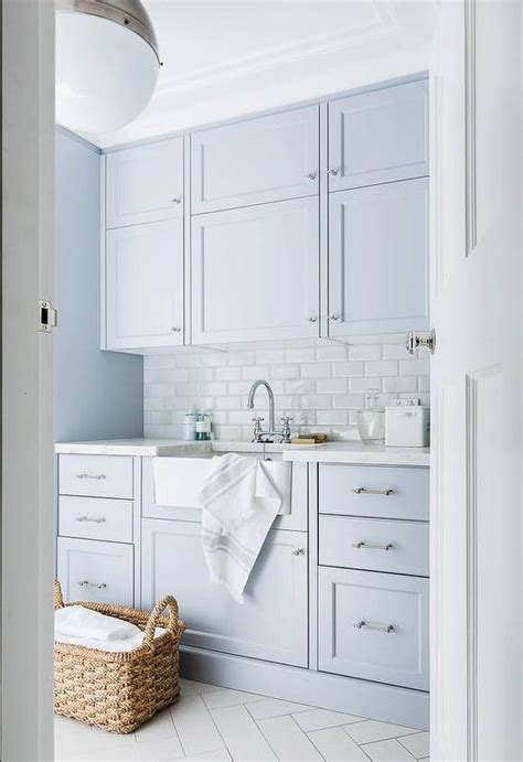 laundry room white cabinets blue laundry room cabinets with white subway tiles
