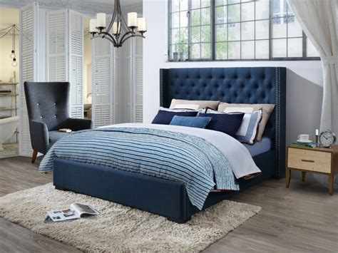 camas con cabecero acolchado cama massimo cabecero acolchado de 160x200cm tela azul