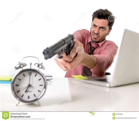 businessman  stress  office computer desk pointing hand gun  alarm clock    time