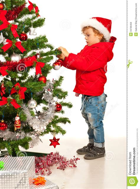 tree with a toddler toddler boy decorate tree stock image image 34796459