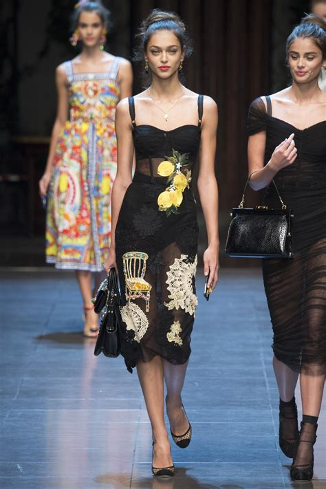 Catwalk To Carpet Rowland In Dolce Gabbana by Hailey Baldwin Flashes At Fashion Week