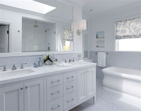 white bathroom vanity blue mosaic tiles backsplash marble herringbone tiles floor