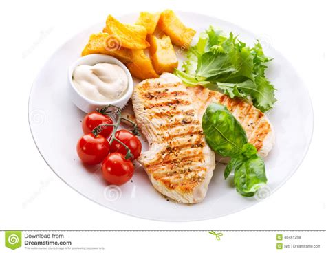 vegetables plate chicken breast with vegetables and sauce isolated on