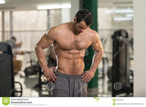 hairy man showing abdominal muscle stock photo image  athlete biceps