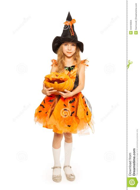 how to dress up as a pumpkin for in witch dress hold carved pumpkin stock