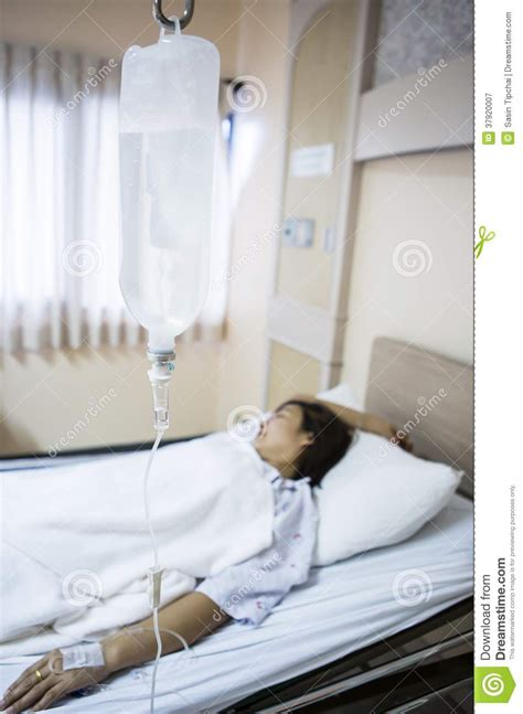 woman in hospital bed woman patient in hospital bed royalty free stock