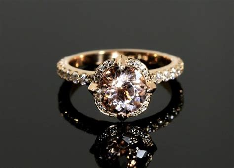 morganite engagement ring with diamonds in gold halo