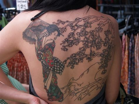 tattooed asian girl geisha design
