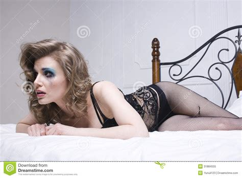 girl laying in bed crying woman laying in bed royalty free stock photo