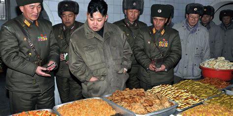 Jong Food jong un looking the splendor of food while the