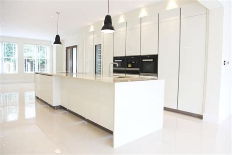 kitchen island downdraft extractor contemporary london designed by monita cheung modern kitchen white gloss