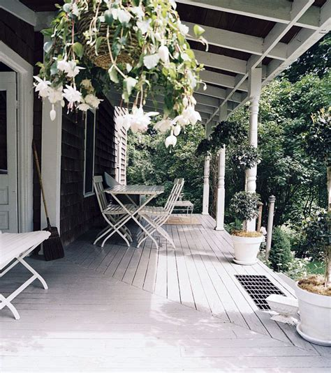 calm white porch  wooden floor design interior