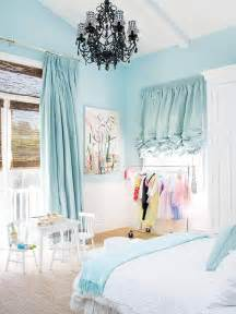Light blue girls bedroom with black chandelier and ruffle curtains