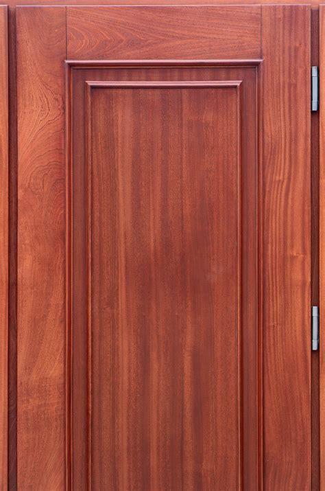 copper door  sidelights lattice design