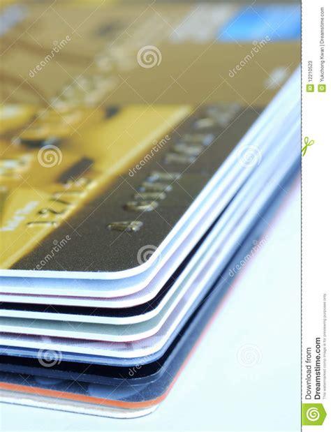 Stack Of Gift Cards - a stack of gift cards and credit cards stock photos image 12210523