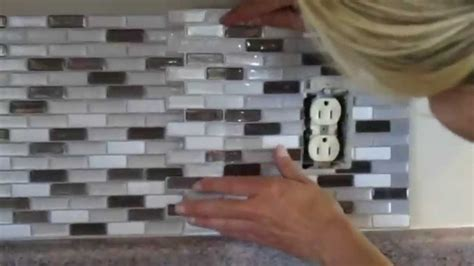 how to cut glass tile backsplash around outlets home how to cut peel and stick smart tiles around an electrical