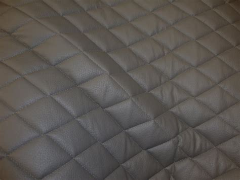 grey quilted vinyl fabric with 3 8 foam backing by
