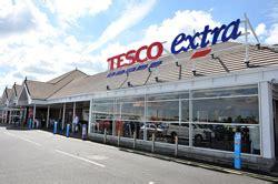 tesco bank profits tesco returns to profit