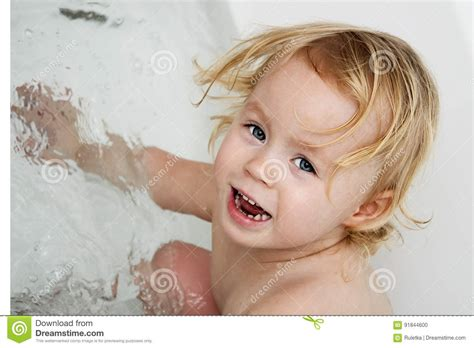 Washing Baby In Kitchen Sink Baby Taking A Bath In The Sink Royalty Free Stock Image