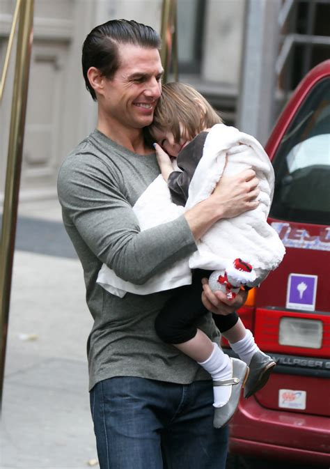 tom and suri cruise win a night at the cinderella castle suite in suri cruise photos tom cruise and suri leaving their