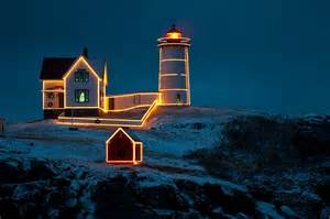 nubble lighthouse lights at nubble light photograph by paul mangold