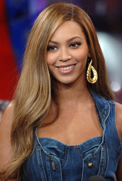 a side part with long hair and a swoop and a cross beyonce knowles long straight side part hair style