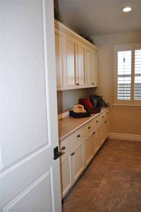 Laundry Room Provides Plenty Of Built In Storage Light And Laundry