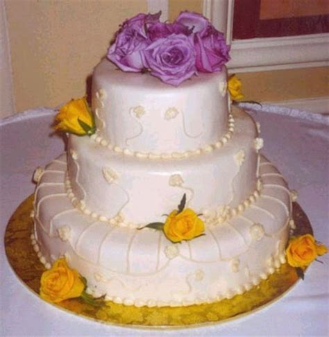 Wedding Cakes With Yellow And Purple Flowers by White Wedding Cake Purple Flowers Topper And Yellow