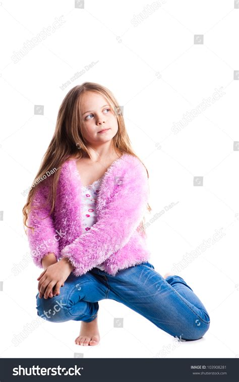 angry little girl in pink isolated on a white background portrait of beautiful little girl in pink isolated on