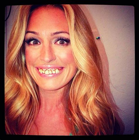 Cat Deeley shows off a scary pair of gnashers as she films