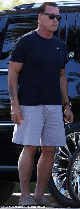 Bad to the bone! Arnold Schwarzenegger shows off tough guy
