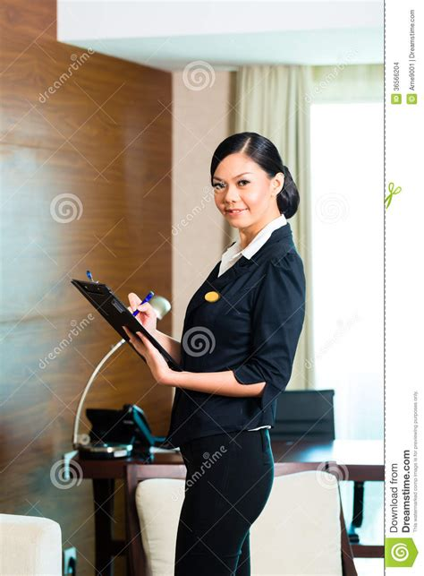 Executive Housekeeper by Asian Executive Housekeeper Controlling Hotel Room Stock Images Image 36566204