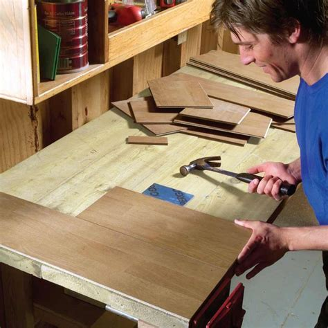 use scrap laminate flooring to cover work bench