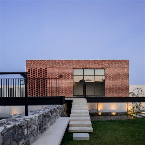 architects and designers houses dezeen delfino lozano s casa g features an elevated brick games