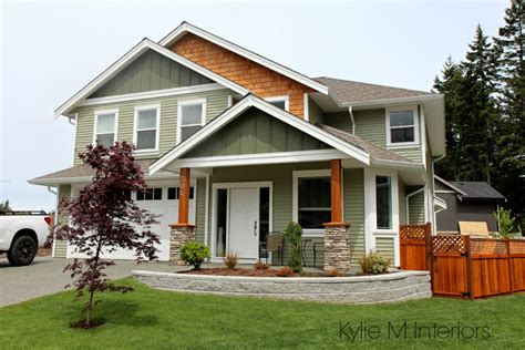 exterior colour palette with green vinyl siding cedar shingles and cloud white trim by m