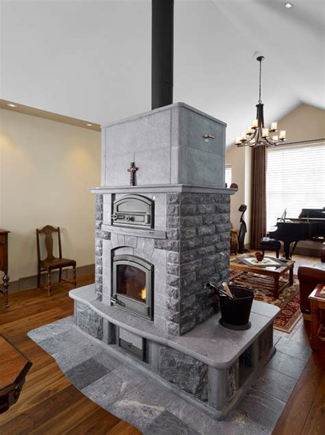 Traditional Bedroom Interior Design - tulikivi soapstone fireplace traditional family room edmonton by habitat studio
