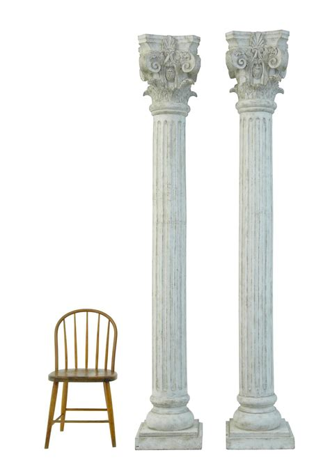 The Decorative Top Of A Column by Large Pair Of Decorative Carved Wood Corinthian Columns