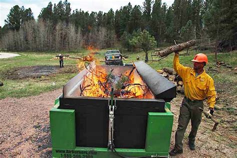 air curtain incinerator using an air curtain to burn bug tree debris wildfire today