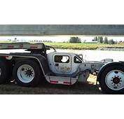 Three Axle Steer Car Hitched To A Four Jeep With