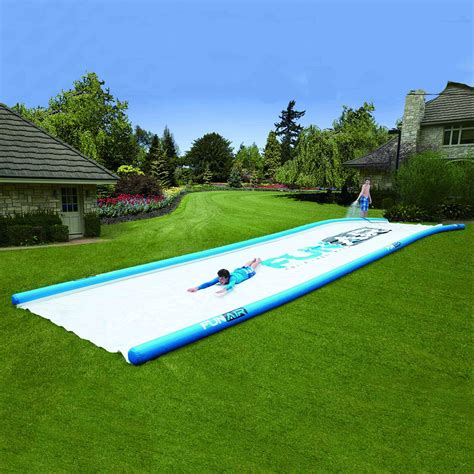 gigantic backyard water slide the green head