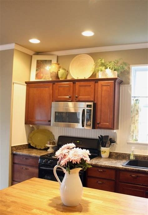 how to decorate on top of kitchen cabinets decorating above kitchen cabinets freshomes
