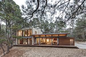 house with studio contemporary forest house with curved metal roof