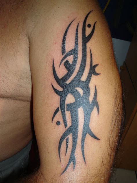 tribal tattoos upper arm infinity designs arm tattoos
