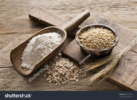 whole grains svenska whole grain and flour on wooden background up stock