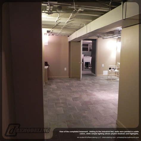 exposed basement ceiling warm neutral basement remodel contemporary basement